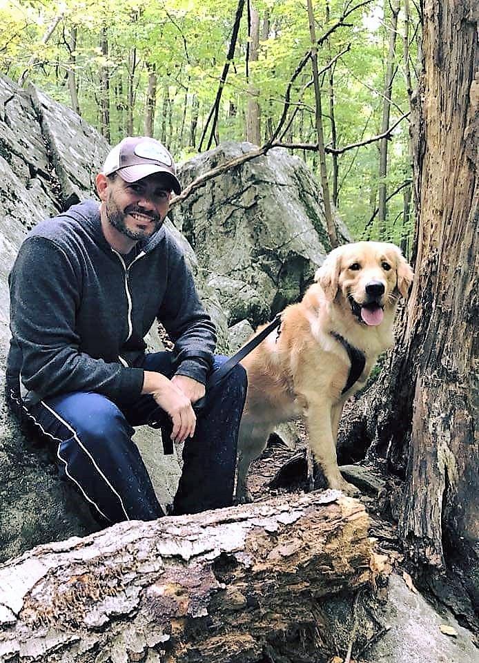 Dash (Shire x Jack) and Tim hiking on the Appalachian Trail